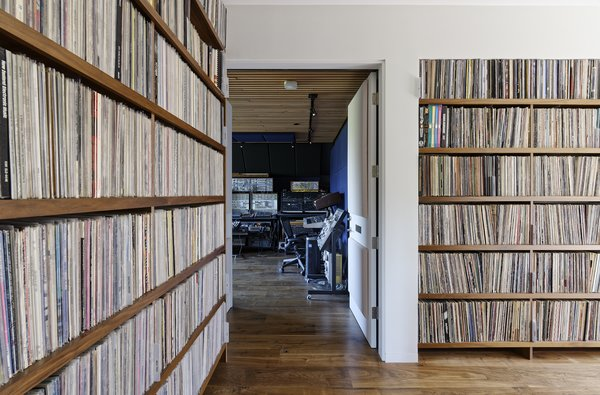 Downstairs are more shelves of records, the master and guest suites, and Jack's music studio.