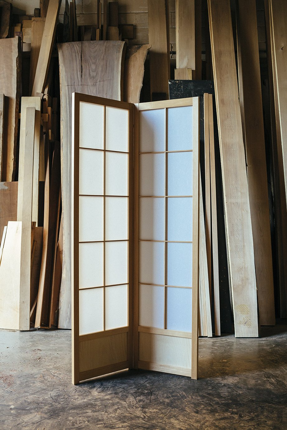 The Hanafusas' specialty is the double-sided shoji, which has a removable second frame that sandwiches the paper. The style has the added benefit of being sturdier than classic single-sided shojis.  Photo 7 of 7 in Undivided Attention