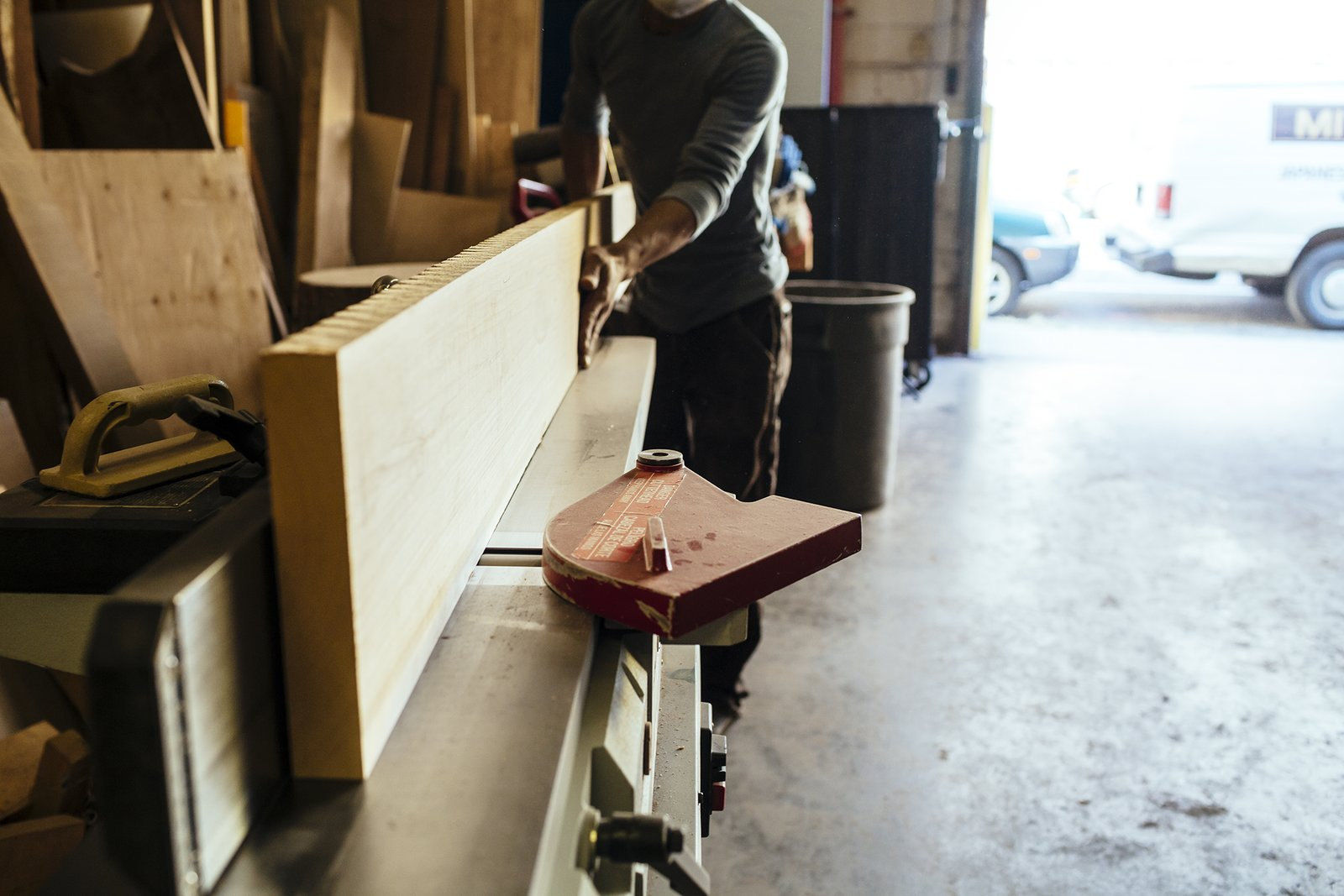 After selecting the lumber, craftsman Naotaka Hamada brings it to a jointer to ensure the wood is straight before cutting into smaller pieces with a table saw.  Photo 2 of 9 in How to Shape a Shoji, Step by Step