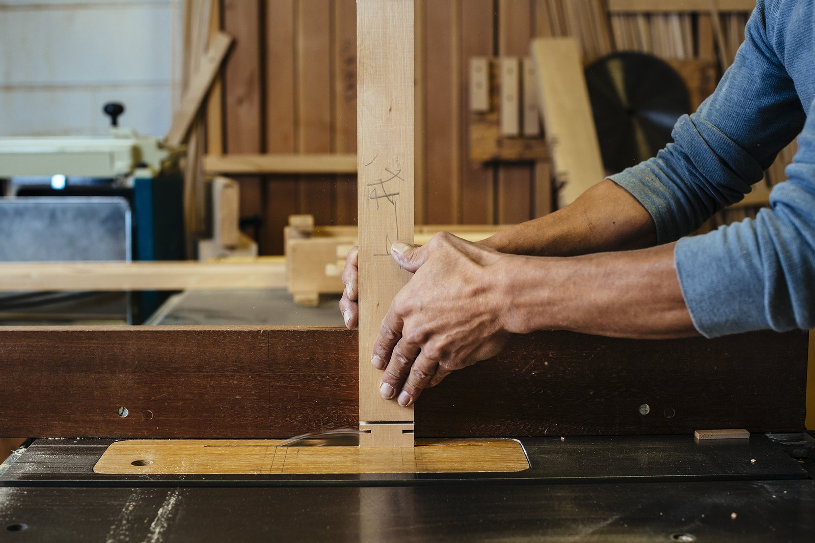 Making the screen is like putting together a puzzle. Here, an attachment on the table saw is used to cut the grooves that will be needed for the final assembly.   from How to Shape a Shoji, Step by Step