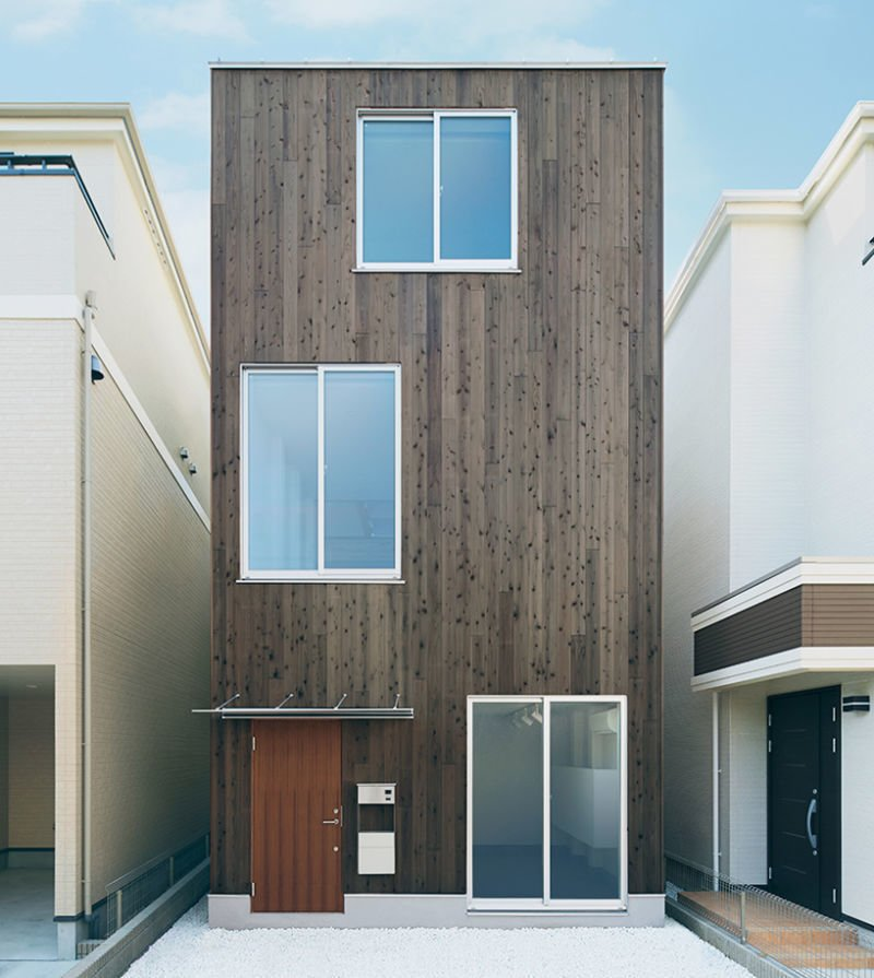 Exterior, Flat RoofLine, Wood Siding Material, Prefab Building Type, and House Building Type Project Name: Vertical House  Website: https://www.muji.com/jp/   Photo 20 of 23 in 22 Modern Prefab Companies That Every Homebuyer Can Rely On