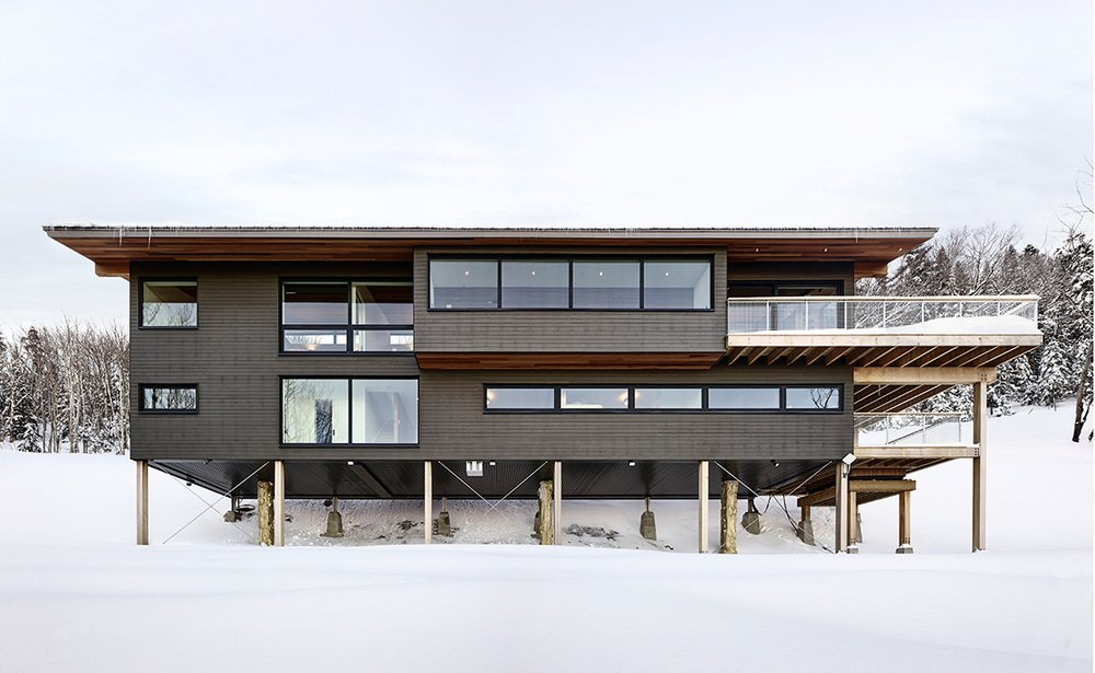 Exterior, Prefab Building Type, Flat RoofLine, and Wood Siding Material Project Name: Laurentian Ski Chalet  Photo 14 of 20 in 19 Modern Prefab Companies Perfect for Mountain Living