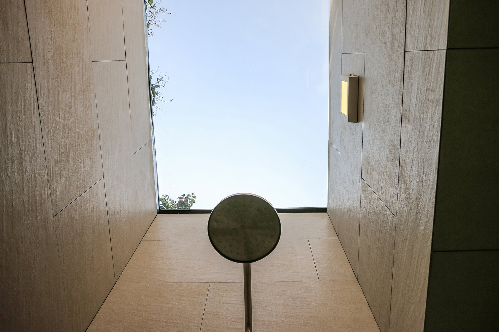 Outdoor and Shower Pools, Tubs, Shower A custom aluminum-framed skylight with a 3M solar membrane floods the bathroom shower with light; the fixture is by Castel.  Photo 7 of 13 in Retired Couple Build Modern in Mexico City