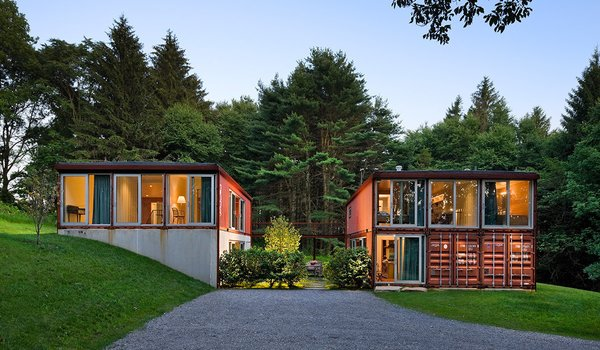 This prefabricated kit house by Adam Kalkin is designed from recycled shipping containers. Its 2,000-square-foot plan includes three bedrooms and two-and-a-half baths. The shell of the Quik House can be assembled in one day, and the entire home can be built in three months or less.