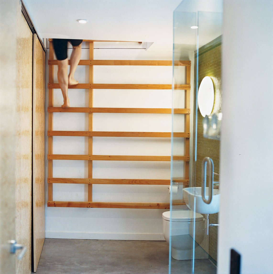 One bathroom features a ladder that leads up to a yoga studio.  Drift Bay House