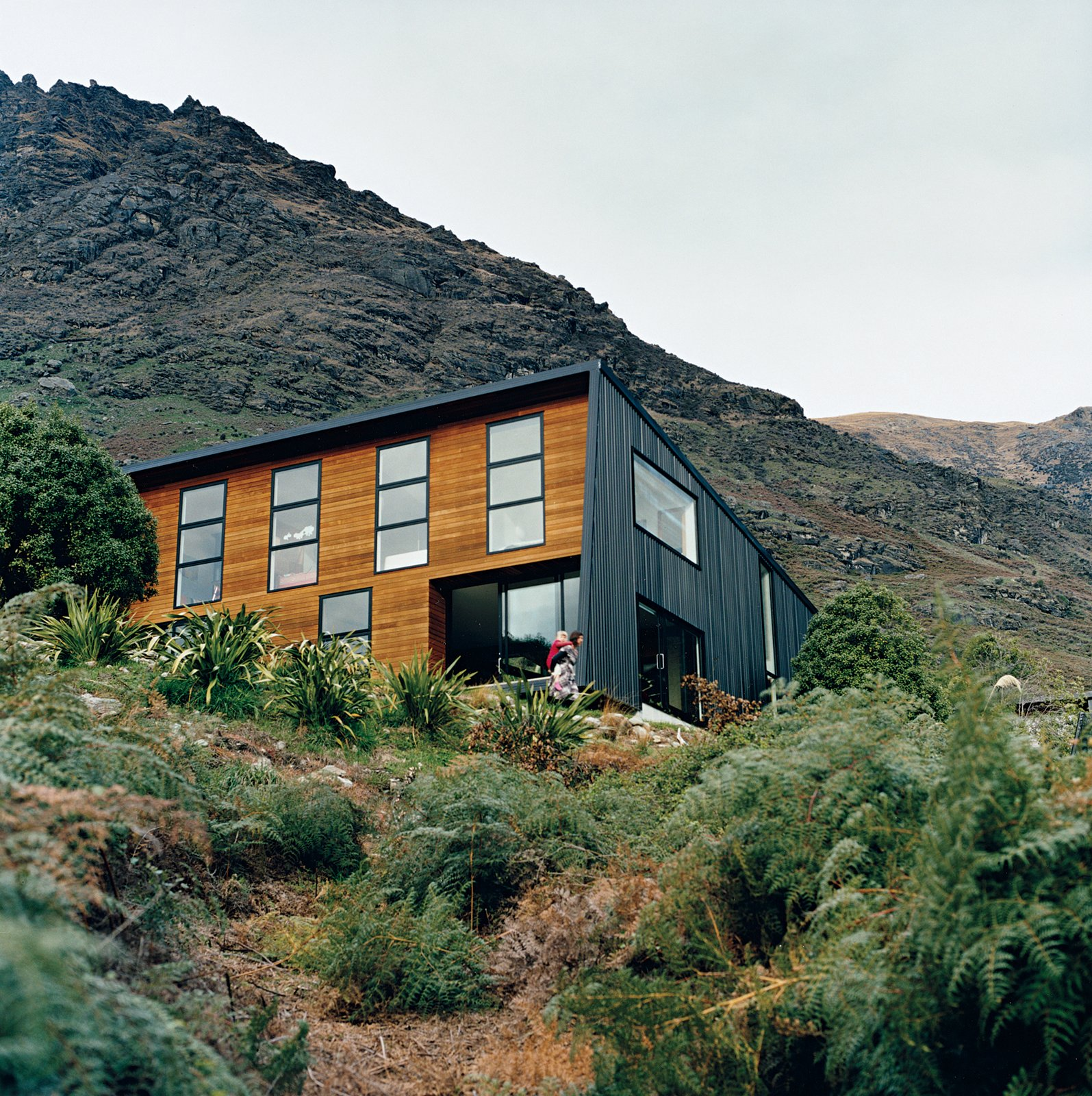 Exterior, House Building Type, Metal Roof Material, Wood Siding Material, and Metal Siding Material The location on the shores of a small bay means it is sheltered from cold southerly winds. The alpine location provided plenty of inspiration for landscaping, which Ritchie and Kerr elected to keep as minimal as possible, as if the home had landed on its site with as little disturbance or alteration as possible.  Drift Bay House