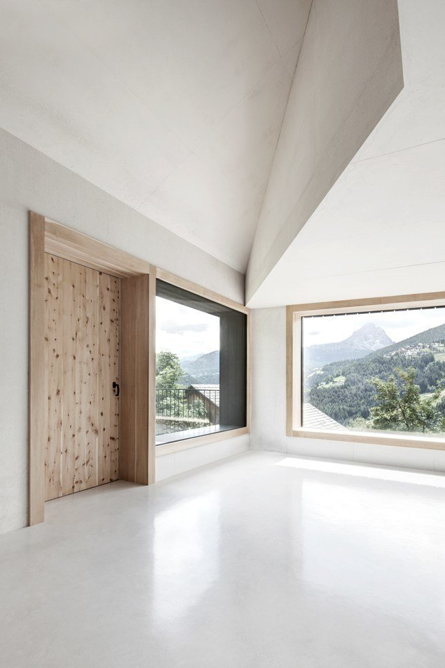 Living Room and Concrete Floor In contrast to the dark exterior, the interior is made of white concrete with aggregates of dolomite rock.  La Pedevilla