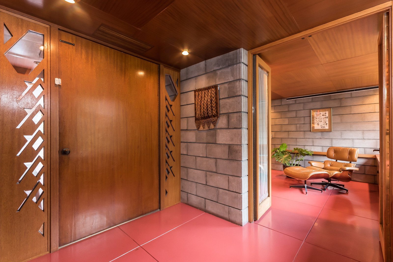 The interior of the home is almost completely lined with mahogany, along with sections of concrete blocks. Wright's design called for different cuts of wood to be placed together, which creates a rich layered effect.   Tirranna