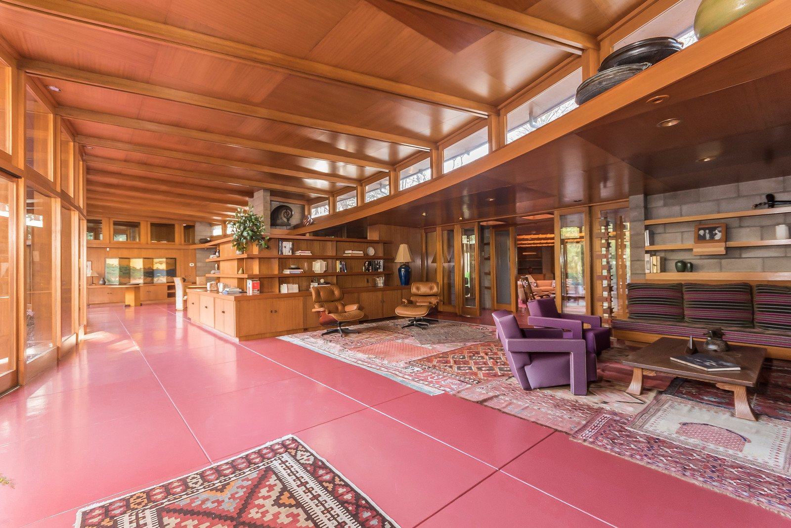 The red flooring that runs throughout the interior is Colorundum in Cherokee red, a color Wright loved to use in his projects. Jim Gricar of Houlihan Lawrence explains that the flooring is made up of a series of minerals that have a low freezing point, which makes it difficult to crack.   Tirranna
