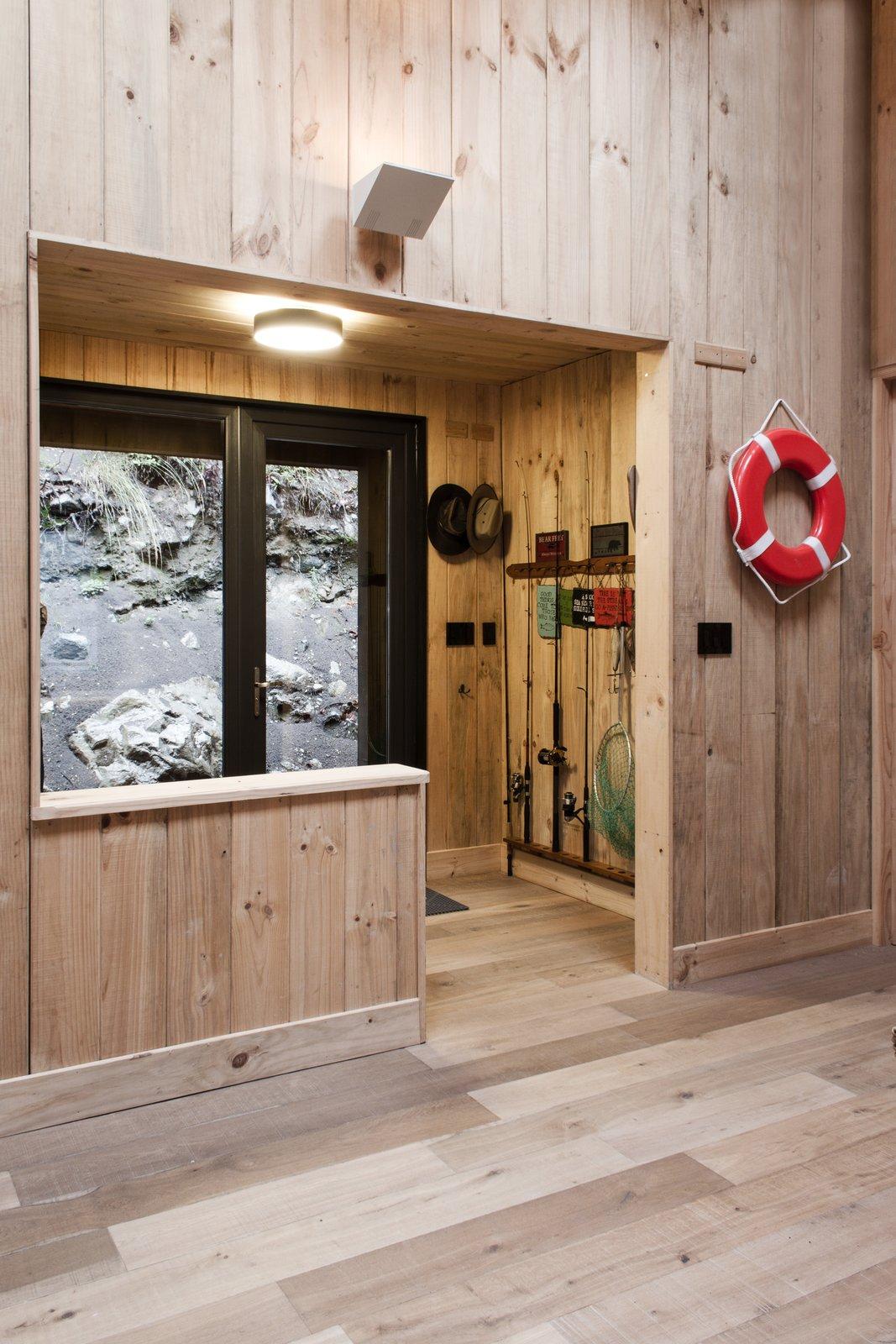 A mudroom has storage space for fishing gear, wet shoes, and jackets.  Casa Lago Todos los Santos