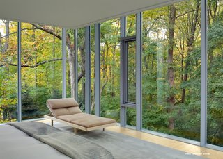 In the master bedroom, Mori custom built a bed with side drawers and lined the space with windows that are outfitted with automatic curtains—both blackout and sheer.