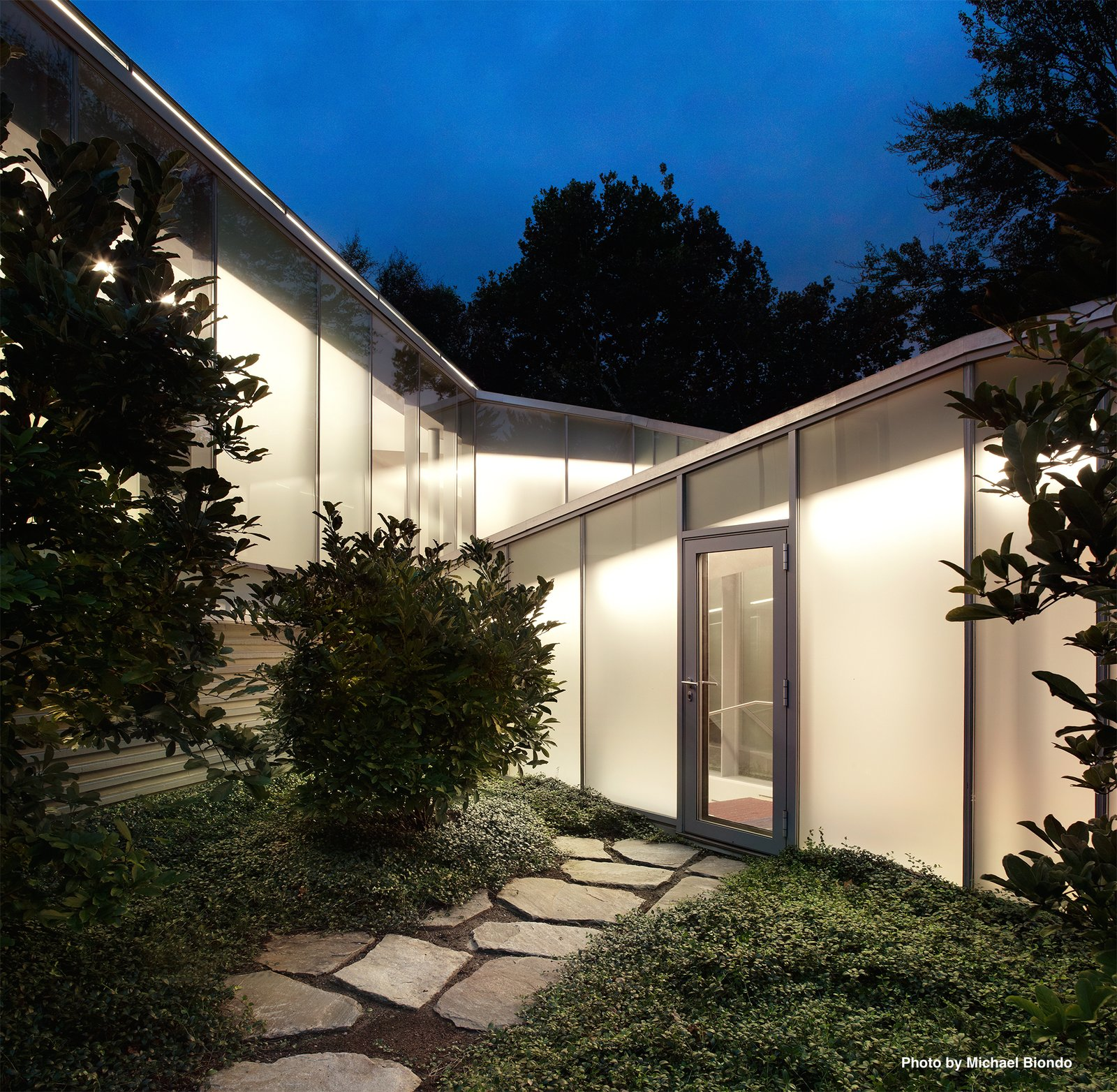 The original Breuer structure is connected to Mori's addition by a triangulated glass corridor that includes a graduated staircase.  Best Photos from Marcel Breuer's New Canaan Home