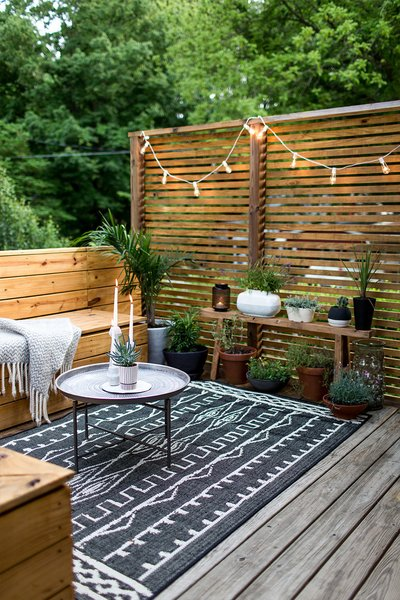 Modern and minimal doesn't mean unlivable, rugs make outdoor spaces inviting.  Photo 1 of 10 in 10 Ways to Use Rugs in Your Outdoor Space This Spring