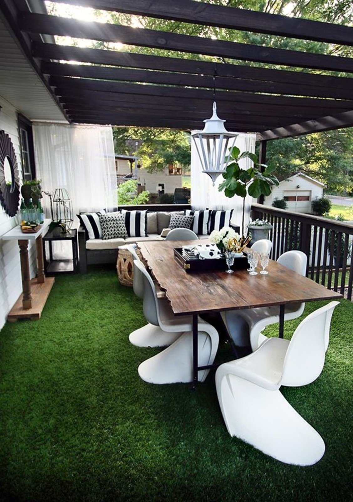 Drought or desertscaping doesn't have to feature succulents only. For rooftop spaces, high-quality astroturf is low maintenance and a great grass replacement.  Photo 4 of 10 in 10 Ways to Use Rugs in Your Outdoor Space This Spring