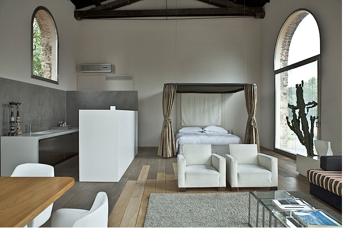 Living Room Chic nomads in search of a vacation home for rent in Italy will love these stylish lofts near the center of Florence. Part of a small hotel-like cluster of apartments converted from an old factory, they offer a truly unique experience for travelers.  Photo 6 of 11 in 10 Rentable Homes in the World's Best Wine Regions