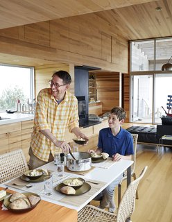 At the IKEA dining table, David Peters and his son, Dashel, enjoy a meal from a Paderno stainless-steel pot made on Prince Edward Island.