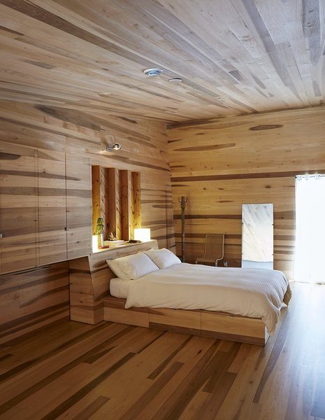 The custom bed features under-mattress drawers.