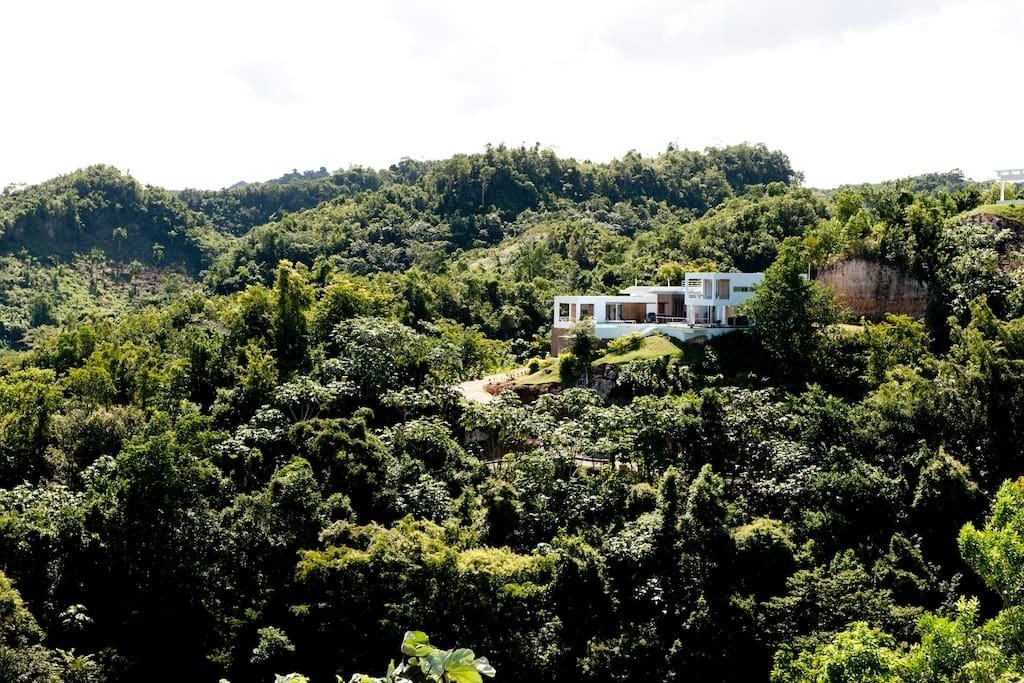 This view of Villa Arboleda shows the incredible amount of rich forest that surrounds the hillside escape.  Photo 4 of 10 in Find Yourself in Paradise at These 10 Modern Rentals in the Caribbean