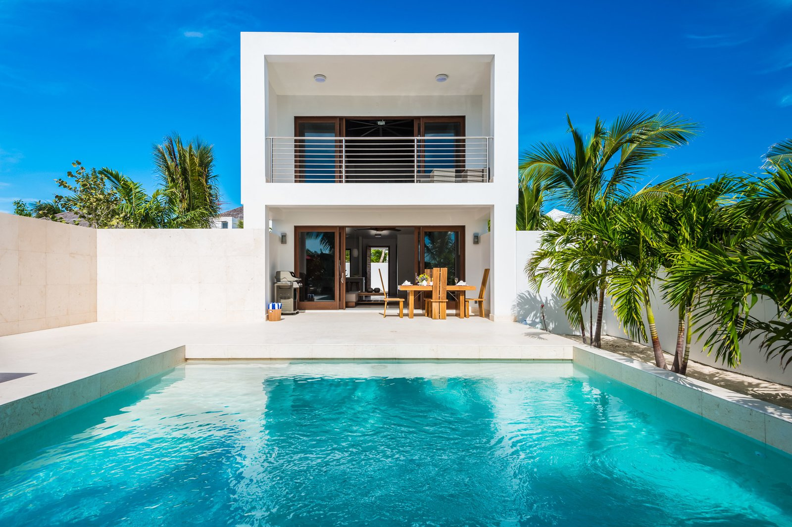 The open-plan living area looks out on an intimate courtyard with an infinity pool.  Photo 9 of 10 in Find Yourself in Paradise at These 10 Modern Rentals in the Caribbean