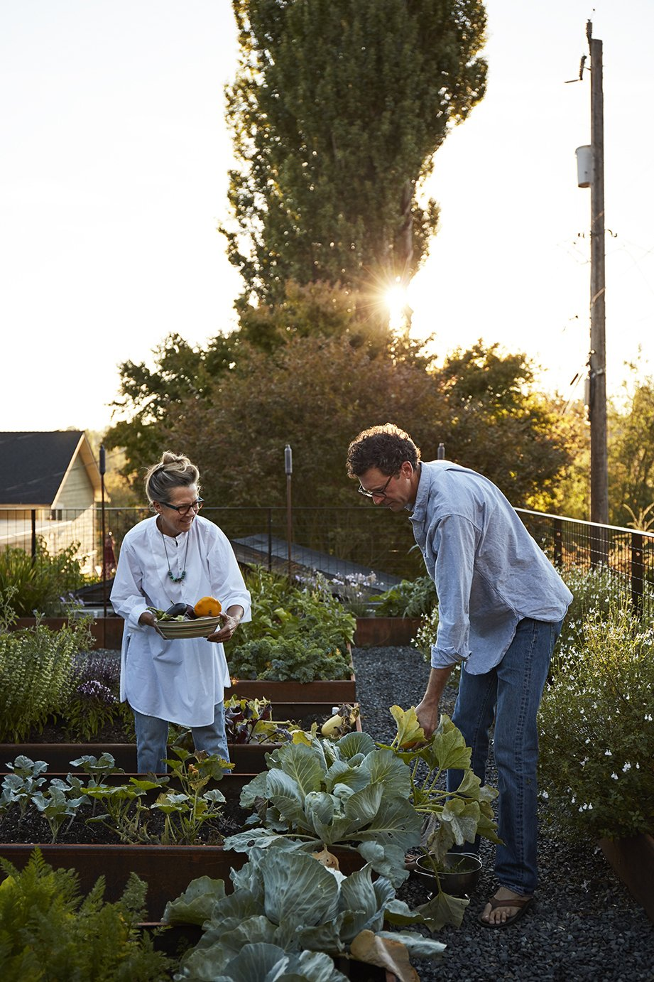Outdoor, Gardens, and Back Yard Despite being located in the middle of the city, the couple's property is flanked by two private gardens and is in close proximity to the Washington Park Arboretum. Ian and Deb often cook using fresh vegetables from the garden, which is equipped with a PVC irrigation system.  Photo 8 of 15 in Greener Grass