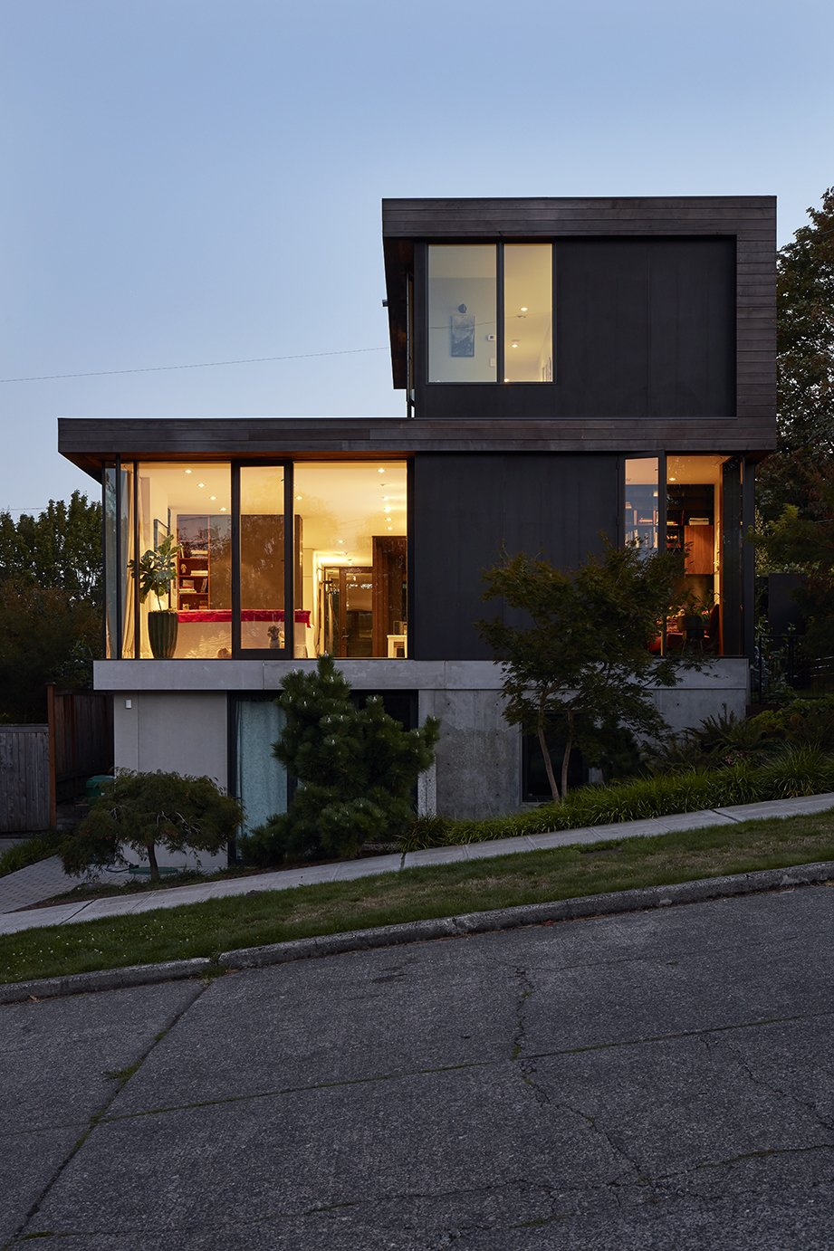 Exterior, Wood Siding Material, Stucco Siding Material, and House Building Type The structure is sited on a slope that dips to the east, allowing for a generous basement that Ian uses for his business, Treebird Construction.  Photo 12 of 15 in Greener Grass