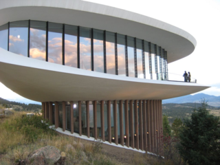 Designed by Charles Deaton and completed in 1965, the Sculptured House is listed on the National Register of Historic Places and can be seen clearly from Interstate 70.