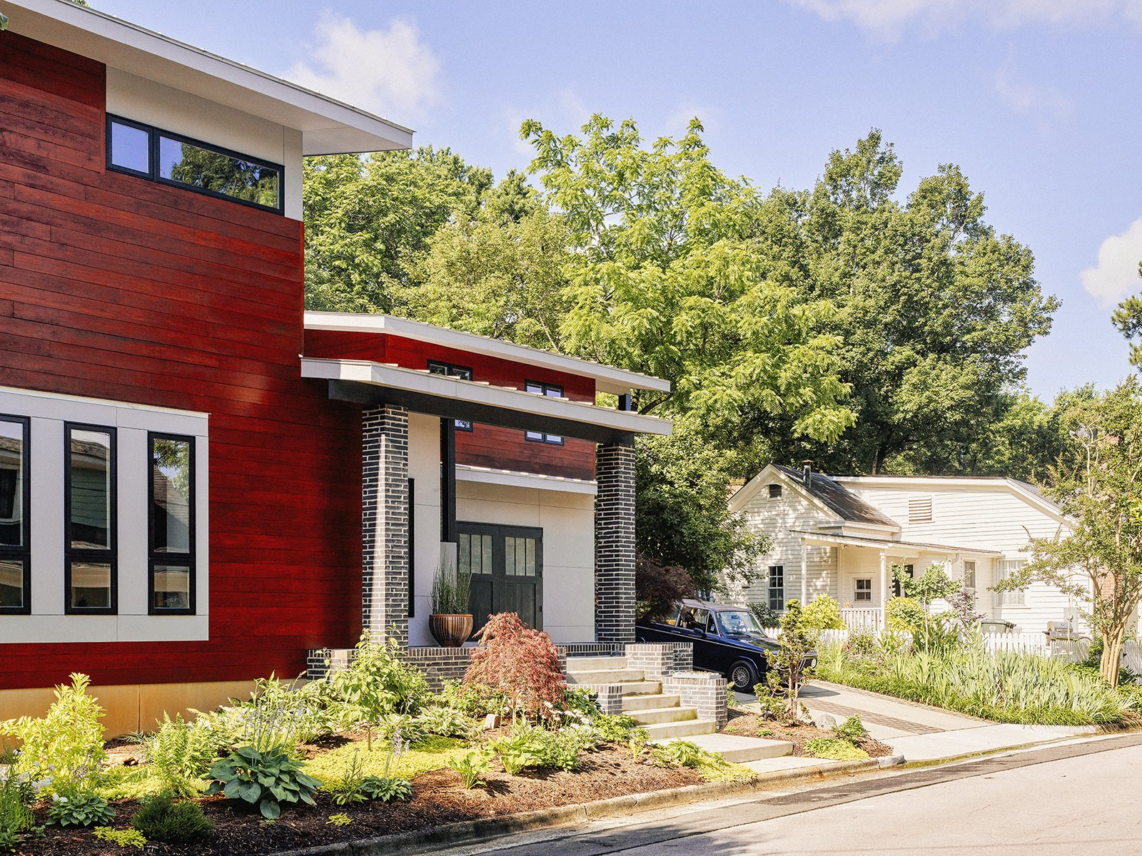 Exterior, Wood Siding Material, House Building Type, and Brick Siding Material The modern exterior of the home upset the couple's neighbor, a real estate agent who felt the design would have a negative impact on property values.  Photo 3 of 10 in Shelter From the Storm