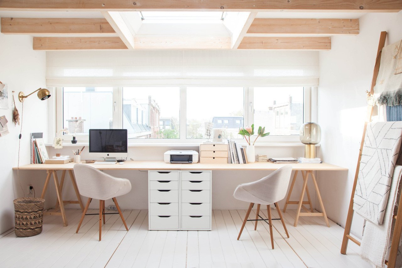 This attic/top floor flat serves as a photo, branding and textile design studio for the lifestyle blogger and designer who calls it her work/place.  Photo 4 of 10 in 10 Ways to Create a Modern Workspace in Your Attic