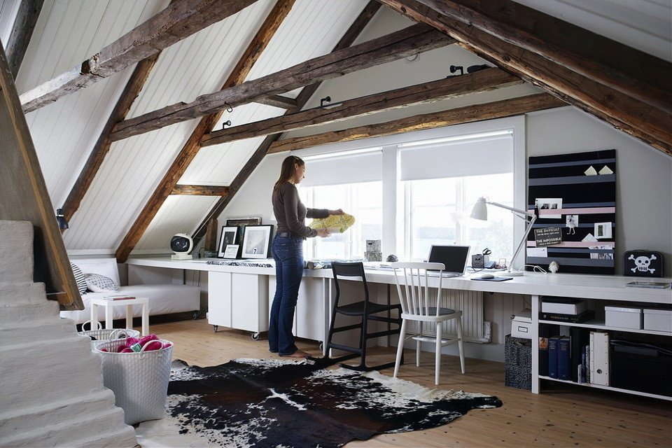 Monochromatic color palettes create visually cohesive looks and draw your attention to natural elements used in the architectural details of a space.  Photo 5 of 10 in 10 Ways to Create a Modern Workspace in Your Attic