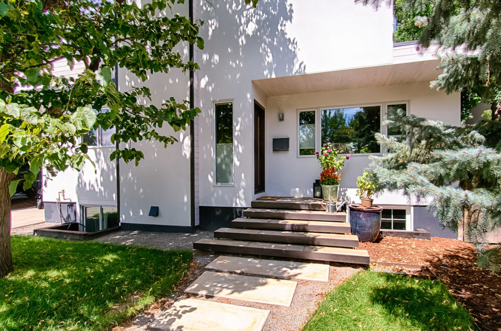 "Exterior, House Building Type, Stucco Siding Material, Wood Siding Material, and Flat RoofLine The building retains its original footprint; this was an important detail for the homeowners who wanted to be as environmentally-friendly as possible. ""The biggest element I work with is to use the existing structure when I remodel,"" says Juilland.  Frischkorn Ranch from This Boulder Home's Unique Bedroom-Bathroom Puts a New Twist on the Open Plan"