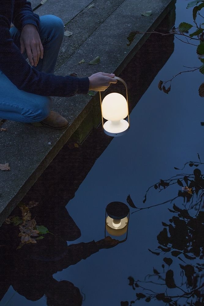 Inma Bermúdez designed this portable, lightweight, and rechargeable light for locations with limited access to electrical outlets. It also has a quirky shape that's both endearing and comfortable to carry around.  Photo 4 of 6 in Extend Your Time Outside With These 6 Innovative Lighting Designs For Your Outdoor Space