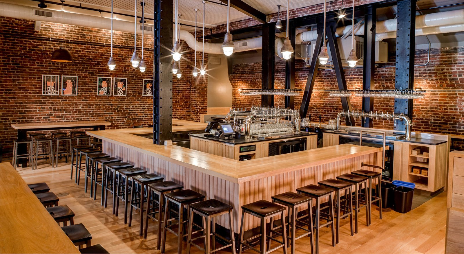 Located in the Tenderloin neighborhood of San Francisco, CA, Mikkeller takes an open-plan approach to their space. By using lighter wood tones, the room feels more bright and airy, perfect for accommodating a large number of people.  Photo 9 of 12 in 10 Brewpubs That Have Tapped the Art of Modern Design