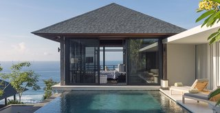 Perched atop a cliff, Villa Hamsa is a four-bedroom, fully staffed villa in the southernmost section of Bali's Bukit Peninsula. It has generous dining spaces, a large infinity pool, and its own gym and massage room.