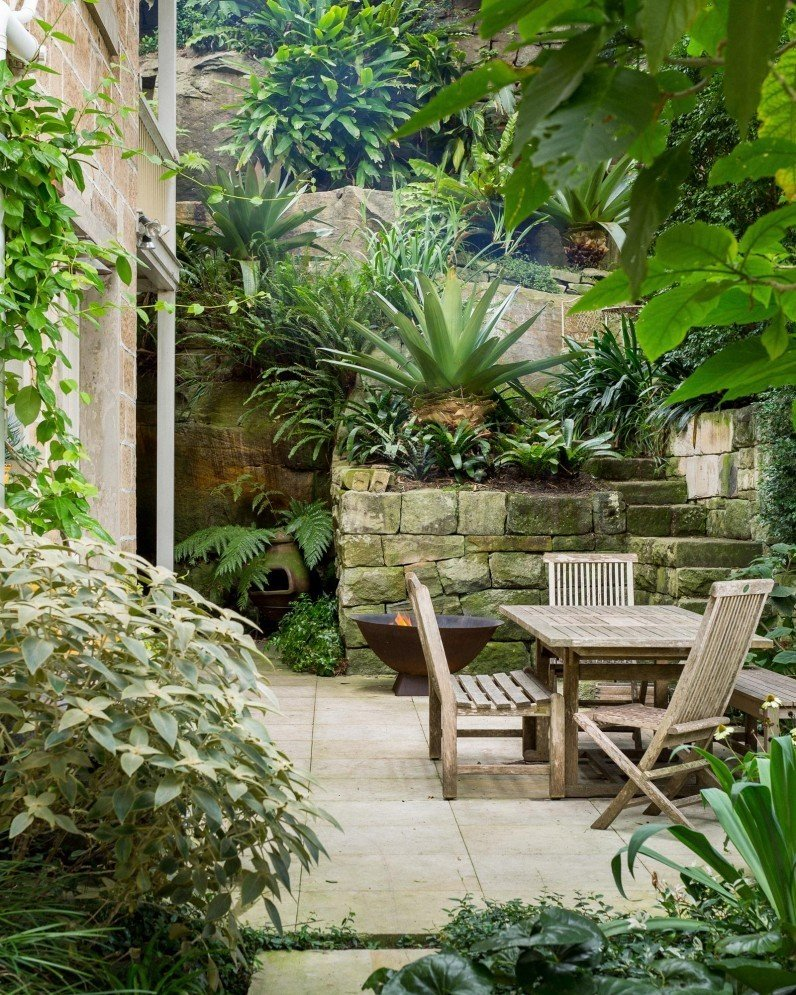 As the founder of one of Sydney's leading landscape companies, Michael Bates updated the garden of his 100-year-old sandstone home in North Sydney. He augmented the existing plantings and made the spaces more functional and ready for entertaining. He chose a focused selection of plants with broad leaves.  Photo 2 of 11 in 10 Modern Gardens That Freshen Up Traditional Homes