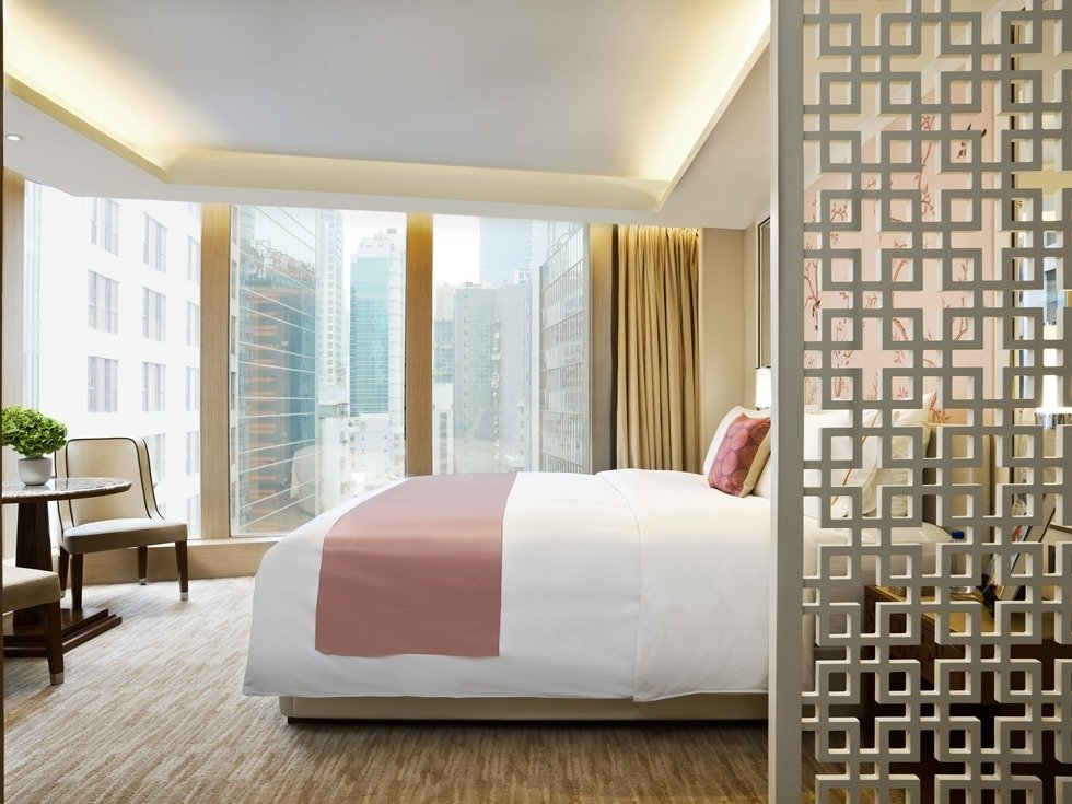 Located in the heart of Hong Kong's downtown core, The Pottinger's 68 luxury rooms and suites celebrate Hong Kong's rich cultural heritage with chinoiserie details and striking photographs from famous Hong Kong photographer and filmmaker Fan Ho.  Photo 10 of 11 in 10 Modern and Stylish Places to Stay in Hong Kong