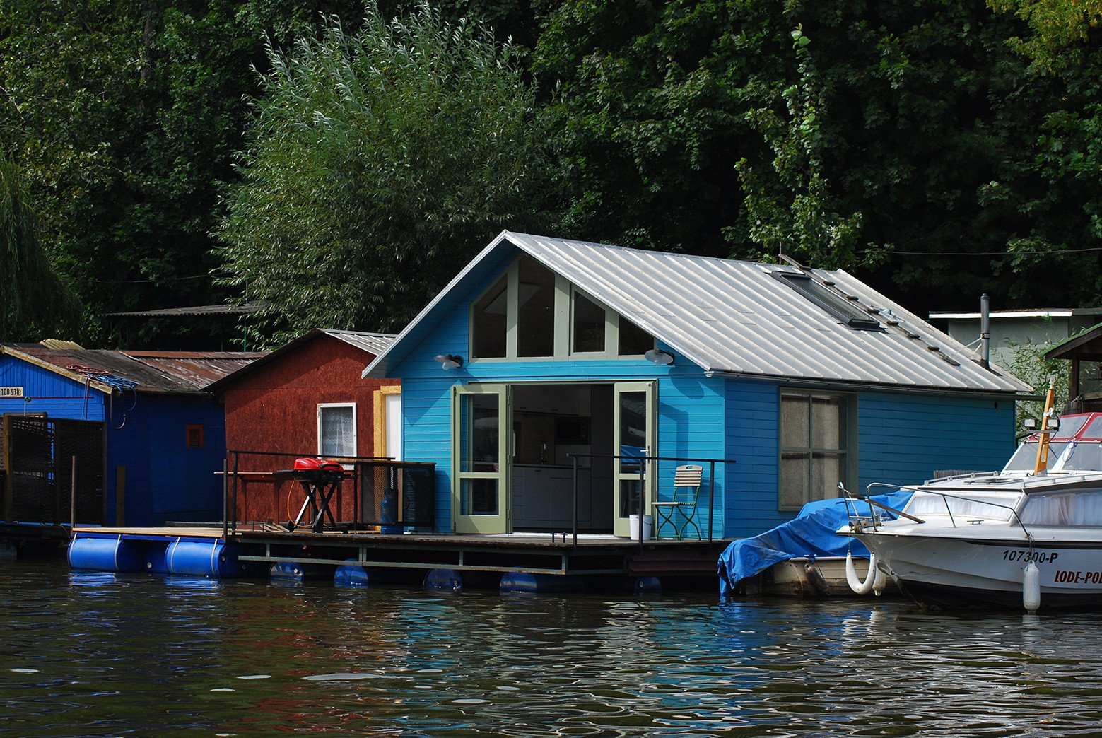 floating homes lake houseboat with gable roofline