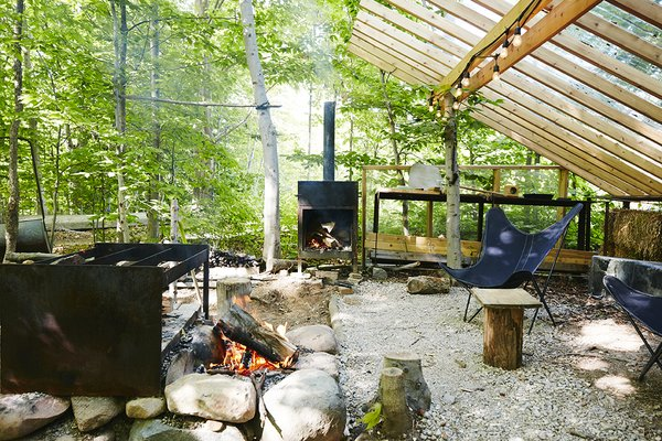 """Joel Loblaw, a landscape designer, created """"a series of outdoor rooms,"""" including an alfresco kitchen that is sheltered beneath a cedar trellis. The Butterfly chairs are from Fresh Home and Garden in Toronto."""