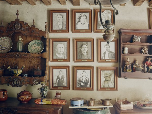 """A wall of portraits pays tribute to Lolo's ancestors. """"All the men in my father's family were called Joseph Honoré,"""" he says, """"but my mother wanted to call me Laurent, after her brother."""" The family tradition prevailed, but his mother insisted on calling him Lolo (pronounced Lu-lu)."""