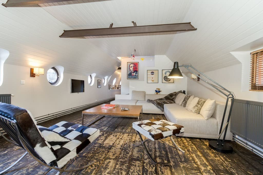 This large Parisien péniche with modern furnishings has a spacious sunny terrace with an outdoor kitchen, and more than 20 river-facing windows, which let in plenty of natural light.  Photo 11 of 11 in Make Yourself at Home in One of These Small Spaces on Boats That You Can Rent