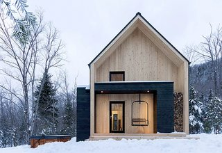 Just 10 minutes away from Quebec's popular ski area Le Massif de Charlevoix, this Scandinavian-inspired cabin is much larger than it looks, and can comfortably accommodate up to 14 guests.