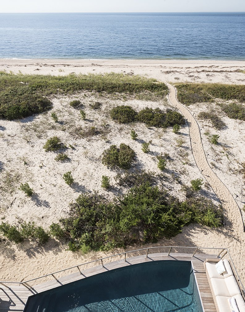 Outdoor, Back Yard, Front Yard, Side Yard, Shrubs, Swimming Pools, Tubs, Shower, Decking Patio, Porch, Deck, Wood Patio, Porch, Deck, Metal Fences, Wall, and Walkways From there, a private walkway runs to the shore.  North Sea House from Shore Bet