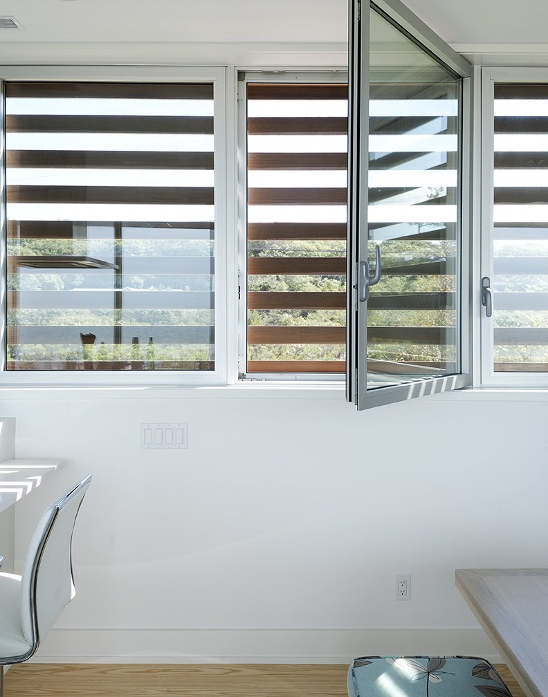 Windows and Metal Cedar louvers veil hurricane windows by Solar Innovations.  North Sea House from Shore Bet