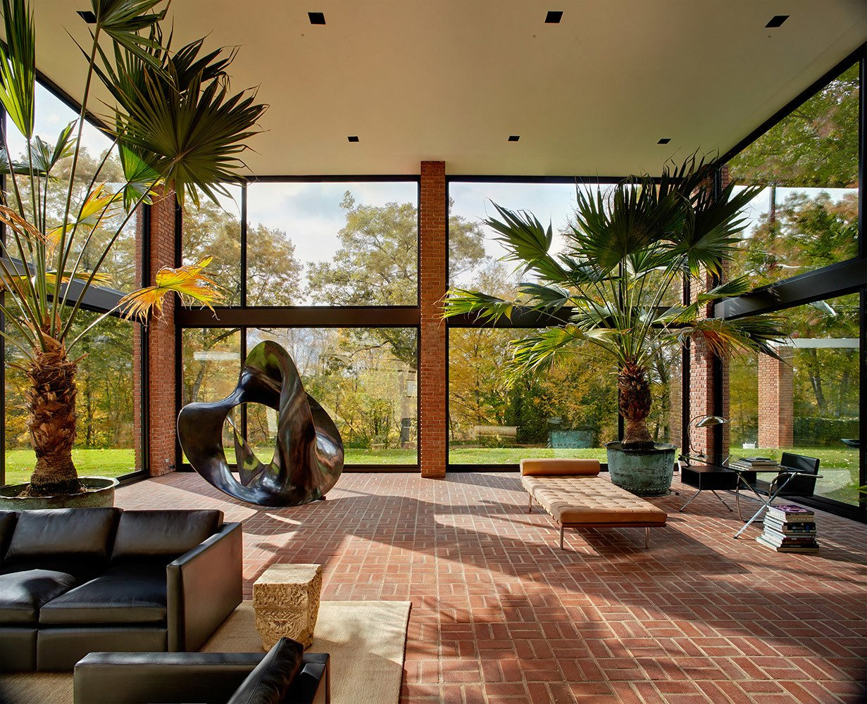 Designed by Philip Johnson for Eric Boissonnas and his family, this house was completed in 1956. Originally designed as a series of pavilions constructed of steel, brick, and glass, the home has since been updated by subsequent owners.  Photo 7 of 8 in There's No Shortage of Glass in These 7 Homes Designed by Philip Johnson