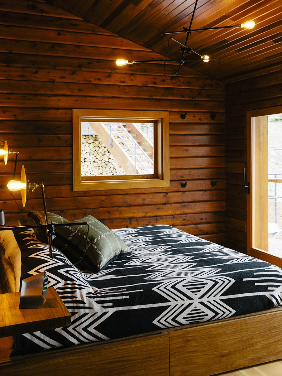Bedroom, Bed, Pendant Lighting, and Wall Lighting The master bedroom's  custom bed has built-in storage. The lighting is by Workstead.  Photo 3 of 13 in An Eclectic Pacific Northwest Cottage