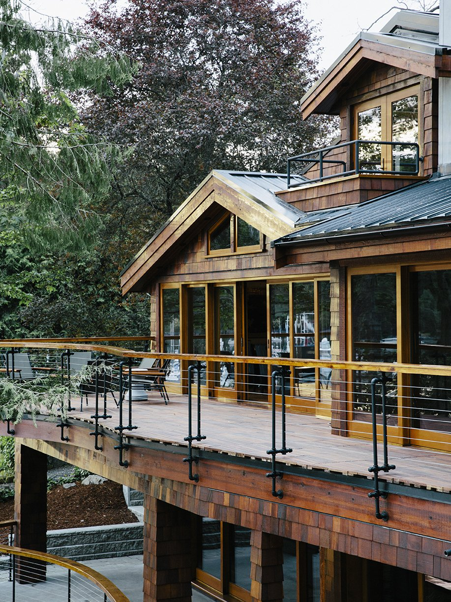 Exterior, Shingles, House, Wood, Hipped, and Gable Conrad used sprinkler pipe material for the railings on the deck, which is made of ipe from West Wind Hardwood.  Best Exterior Shingles Hipped Photos from An Eclectic Pacific Northwest Cottage