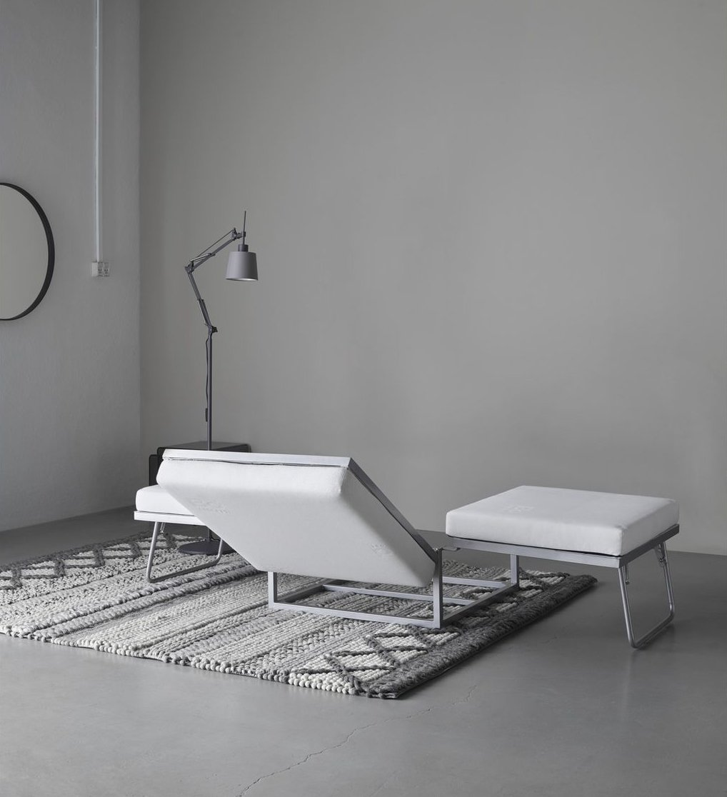 Bedroom, Bed, Rug Floor, and Floor Lighting The Extra ottoman in motion.  Photo 7 of 12 in 10 Functional Pieces For Small Space Living