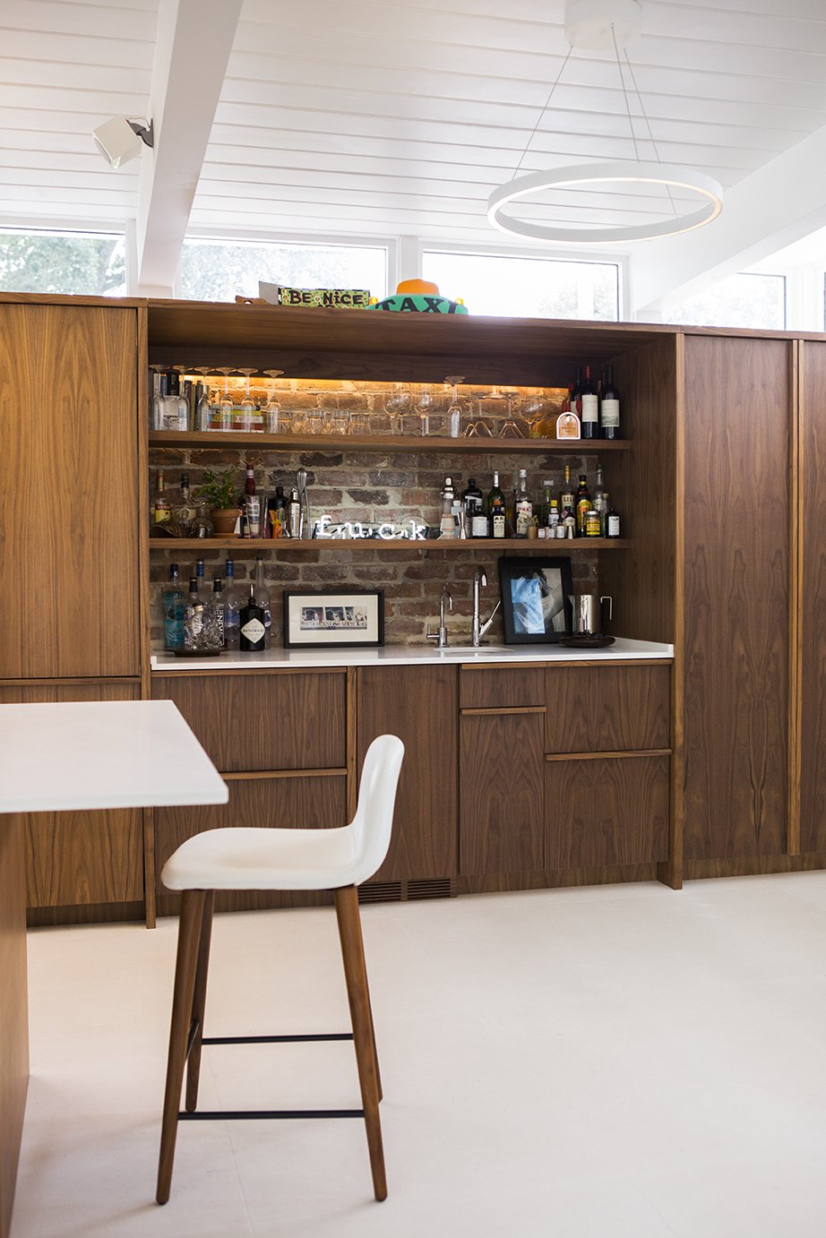 Dining Room, Bar, Chair, Table, and Ceiling Lighting The kitchen and bar millwork is ApplePly with a walnut veneer.  Photo 6 of 13 in Back to the Garden