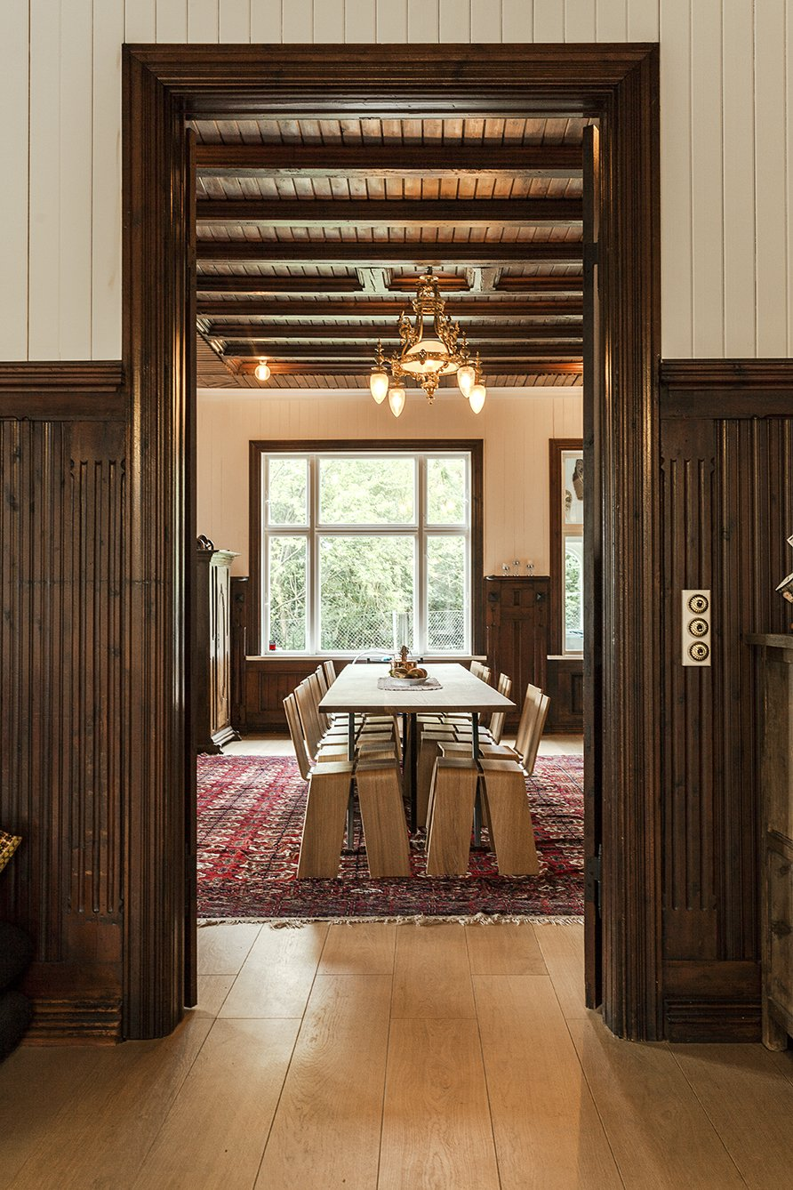 Dining, Table, Chair, Ceiling, Medium Hardwood, Lamps, and Rug Another view of the dining room reveals the original woodwork and character of the 19th-century structure.  Best Dining Lamps Rug Table Photos from This New Old House