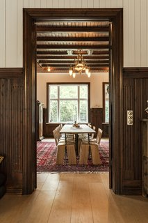 Another view of the dining room reveals the original woodwork and character of the 19th-century structure.