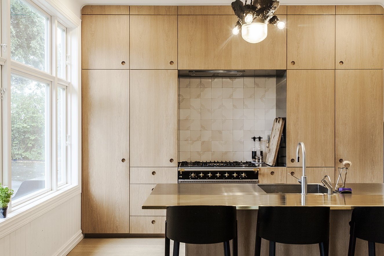In the renovated kitchen, a Lacanche range is surrounded by built-in storage. A state-of-the-art wall-mounted ES2 Strietman brass-and-copper espresso maker by Dutch designer Wouter Strietman adds a jewelry-like touch to the cook space.   Skibsted Residence